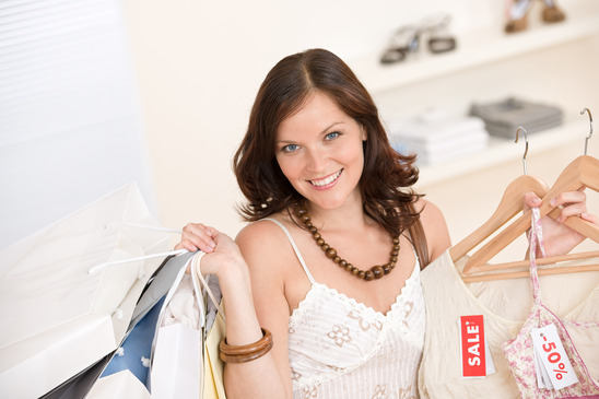 Woman buying clothes in sale