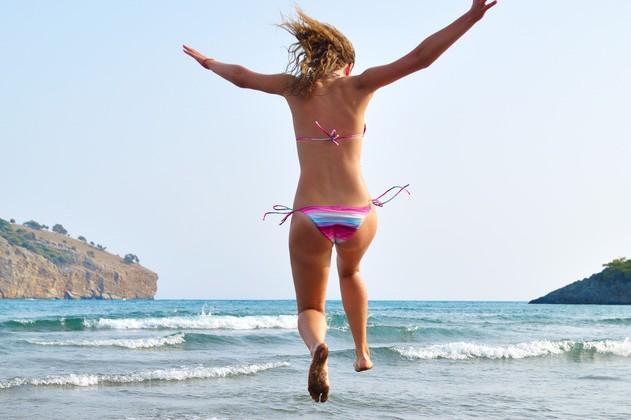Woman jumping into sea