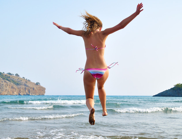 Woman jumping into sea