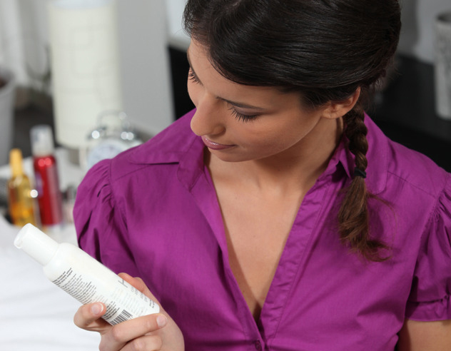 woman looking at beauty products